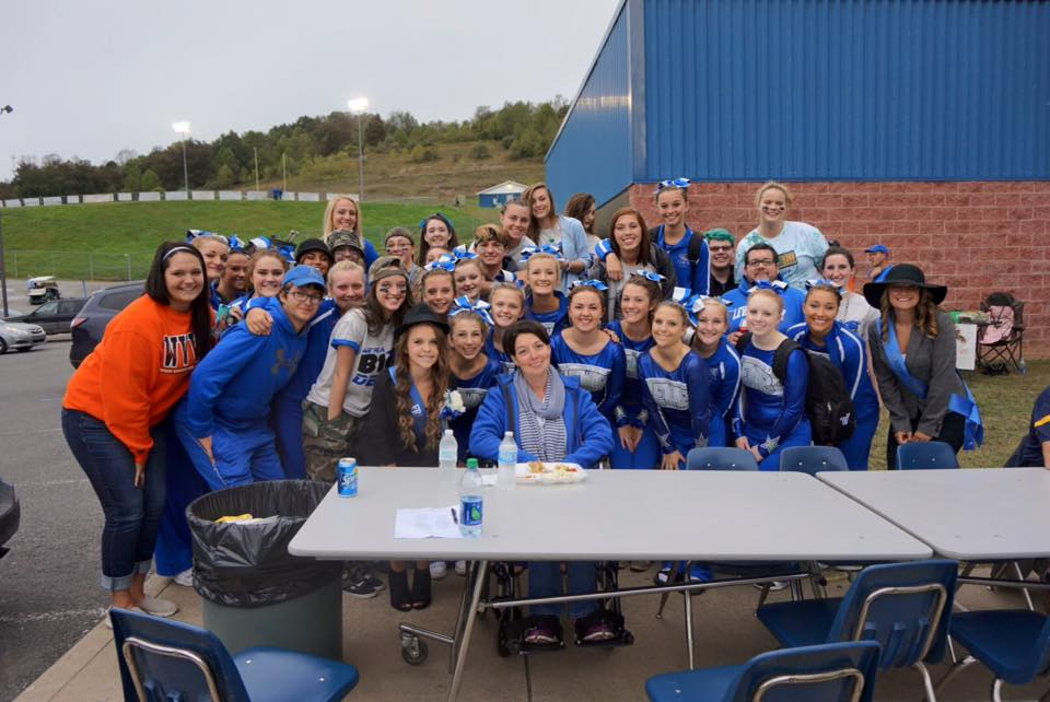 Several members of the LCHS Honor Society, cheerleading squad and War Zone surround beloved teacher, Mrs. Jena Whiston, at the Homecoming Tailgate Fund-raiser to assist with medical expenses incurred from Whiston's diagnosis of Lyme Disease.