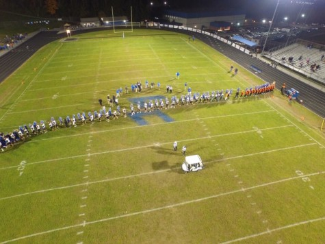 Teams meet on field after LCHS win over Elkins Oct. 23