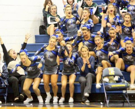 A picture is worth a thousand words... LCHS Cheerleaders and Coaches Beth Nichols (L) and Tiffany Litton (R)  hear