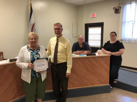 Mrs. Sharon Jerden is presented a certificate of appreciation by Principal John Whiston in the Oct. 8 LCBOE meeting.