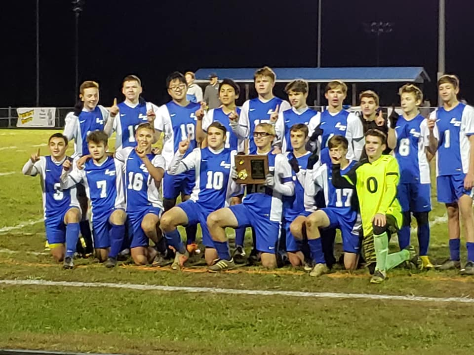 The LCHS Boys' Soccer team members are 2018 Sectional Champs.