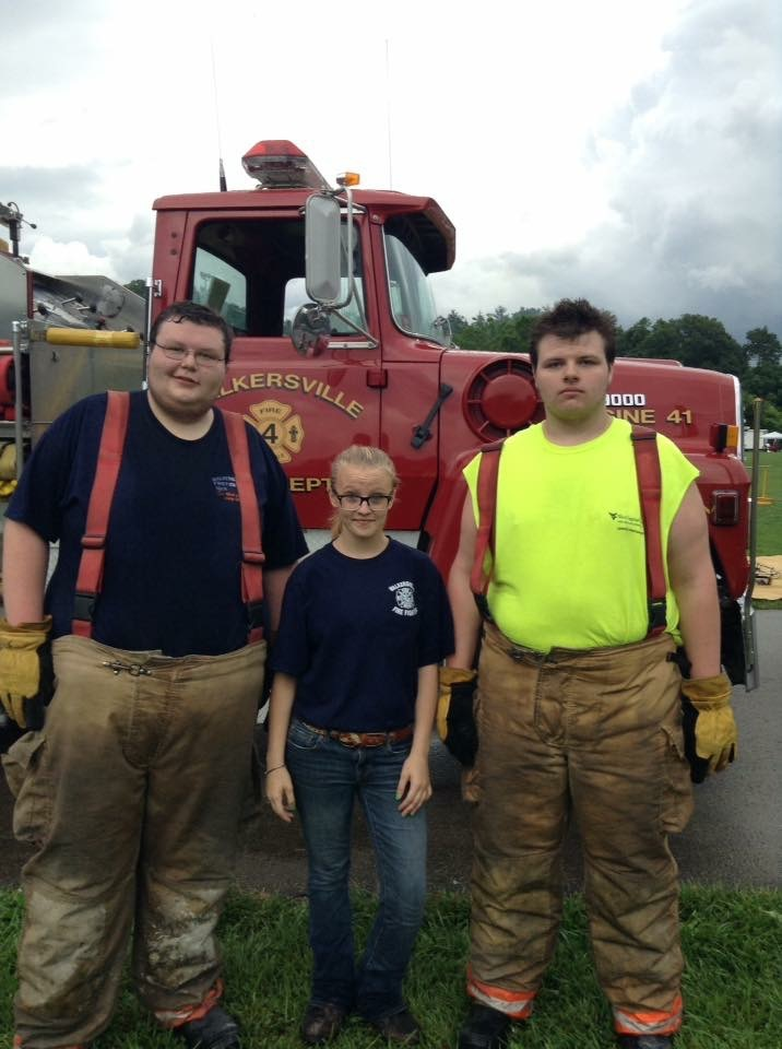 Jessie Jenkins is flanked by two volunteer firemen Nick Riffle (L) and Tyler Riffle (R).