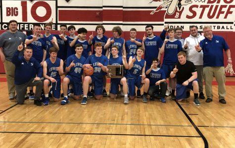 Varsity Boys' Basketball Claims Region II Title