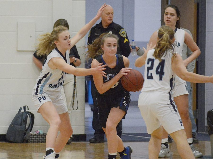 Junior Hannah Brown passes the ball in basketball action.