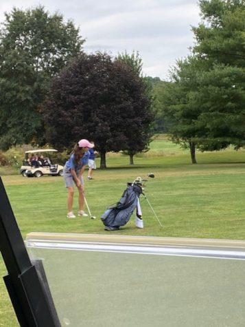Ryanne Garrett, senior, chips one in during the 2020 golf season.