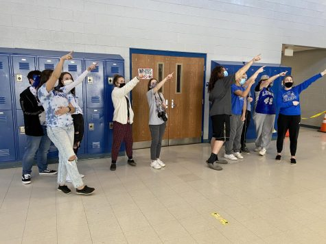 Students point to their favorite banner following the results of Spirit Week.