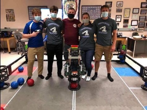 The LCHS Robotics team poses after winning the state championship.  Pictured above, L to R: Ben Goodwin, Owen Spangler, Coach Bill Linger, Claire Lattea, Cameron Lattea.